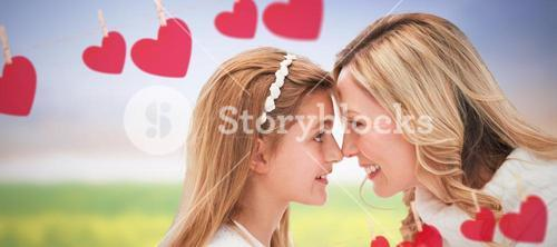 Composite image of happy mother with daughter looking each other against white background