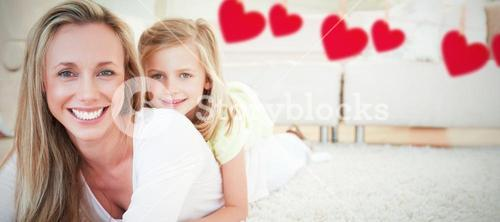 Composite image of mother and daughter lying on the floor