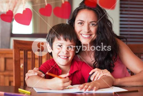 Composite image of happy mother helping his son for homework