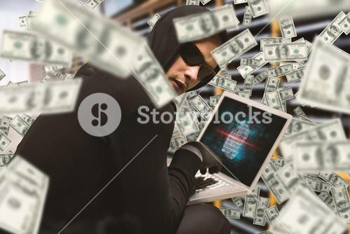 Composite image of hacker using laptop to steal identity