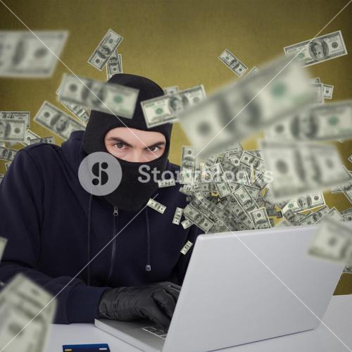 Composite image of hacker in balaclava hacking a laptop