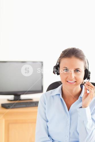 Smiling secretary wearing a headset