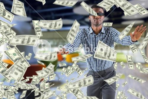 Composite image of blindfolded businessman with arms out