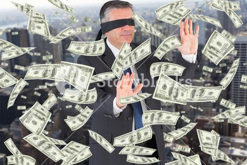 Composite image of mature businessman in a blindfold