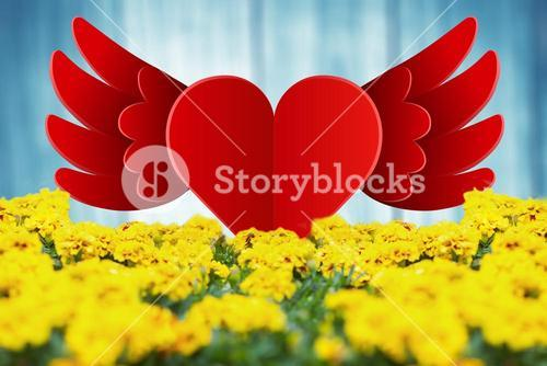 Composite image of heart with wings