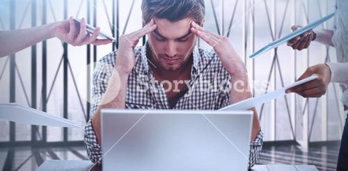 Composite image of businessman stressed out at work