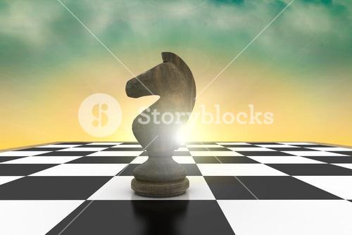 Composite image of black knight on chess board