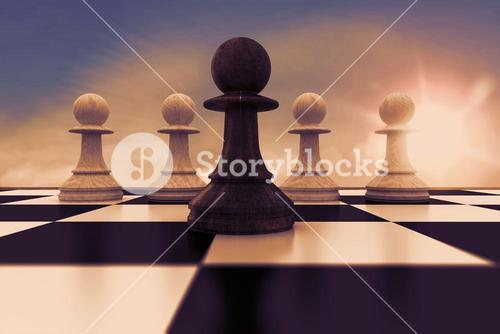Composite image of black pawn in front of white pawns
