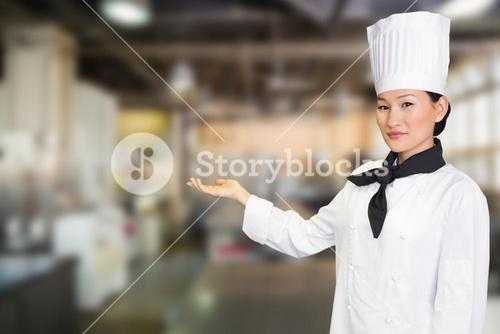 Composite image of confident female cook in the kitchen