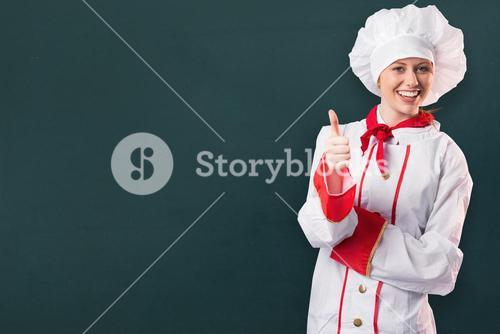 Composite image of pretty chef showing thumbs up
