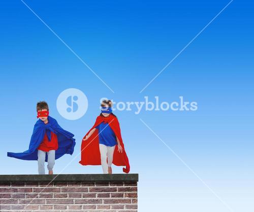 Composite image of masked kids running pretending to be superheroes