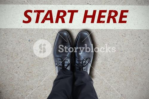 Composite image of businessmans feet in black brogues