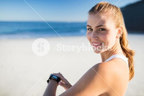Fit woman wearing smart watch