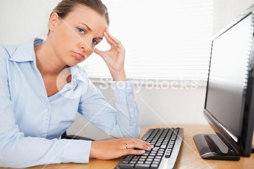 Businesswoman looking into camera at workplace