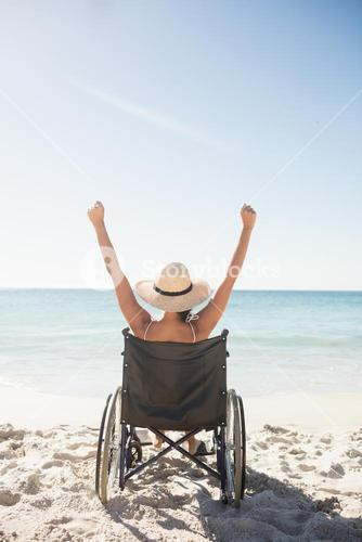 Wheelchair woman sitting  with arms up