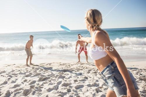 Friends playing with a frisbee