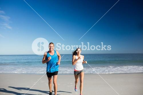 Friends jogging at the beach