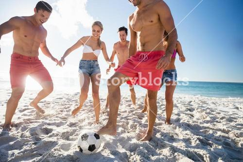 Friends playing football