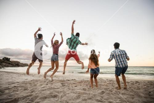 Friends having fun and jumping