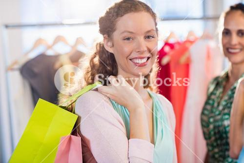 Females friends with shopping bags