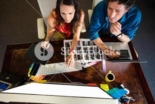 Colleagues using a graphic pad