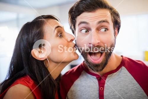 Woman giving a kiss on the cheek