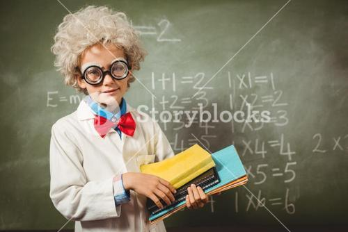 Boy standing in front of blackboard