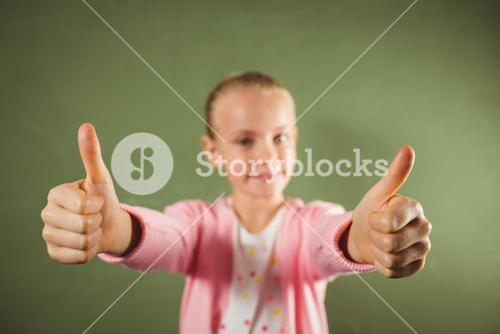 Girl standing with thumbs up