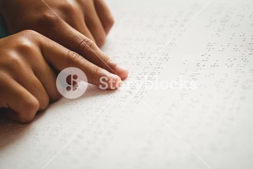 Child using braille to read