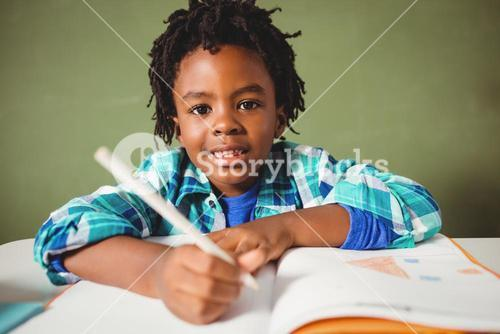 Boy writing in his notebook