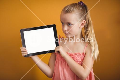 Girl holding a tablet