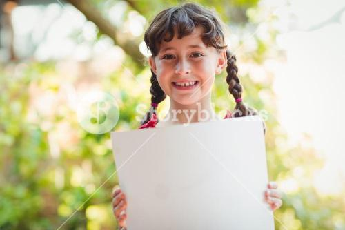 Girl holding a blank sign