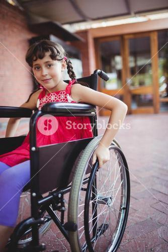 Smiling girl siting in a wheelchair