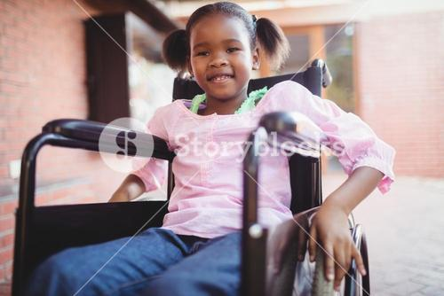 Girl siting in a wheelchair