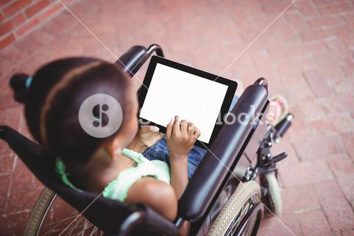 Top view of a girl siting in a wheelchair