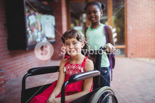 Girl seated on a wheelchair