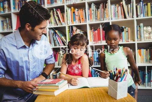 Children and dad at the library