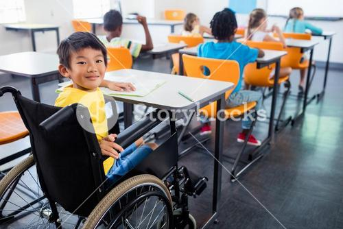 A cute people in wheel chair looking at the camera