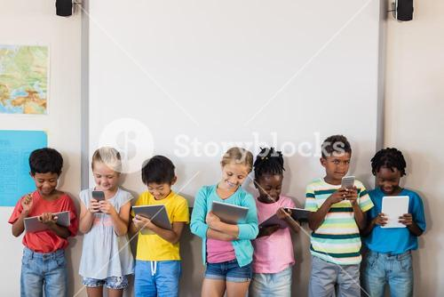 Pupils standing with technology