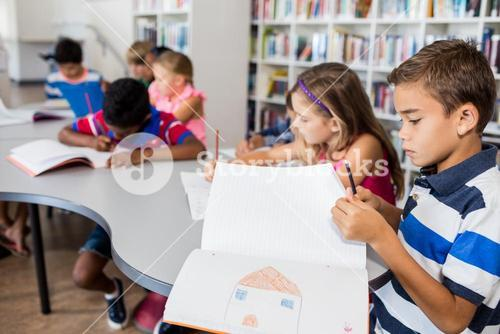 Side view of pupils drawing