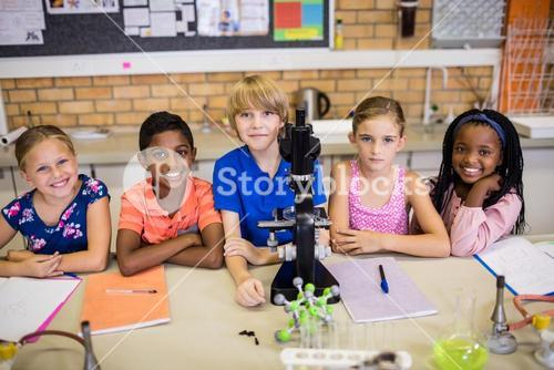 Children posing with microscope