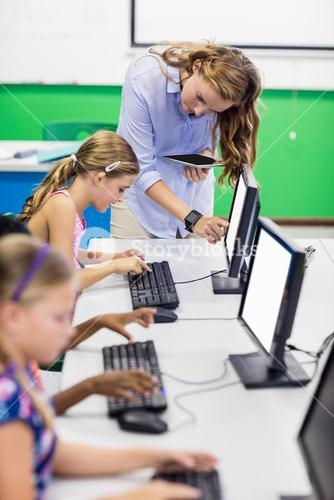 Teacher giving lesson to her students with technology
