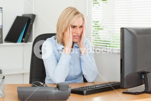 Frustrated working woman in front of a screen