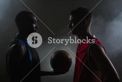 Two basketball player looking each other