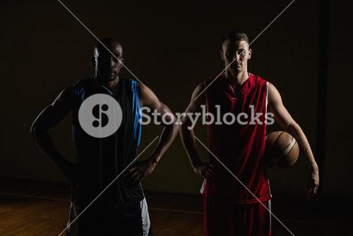 Portrait of basketball players posing with hands on hips