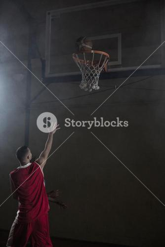 Portrait of basketball player scoring a goal