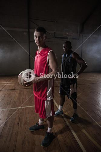 Portrait of two basketball players posing