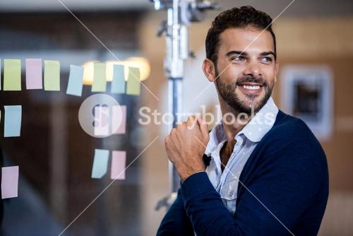 A young businessman looking away