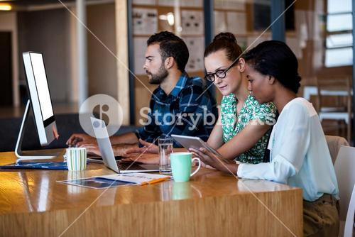 Business people sitting at computer desk