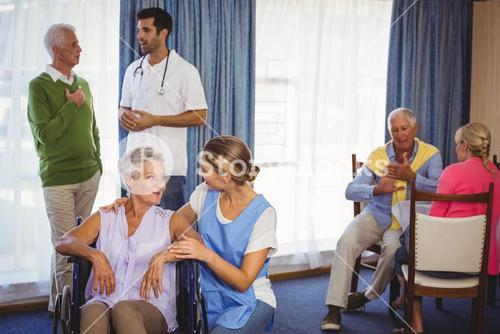 Nurses having discussions with seniors patients